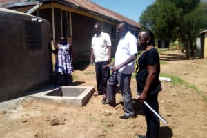 The Water Project: Friends Kaimosi Demonstration Primary School -  Inspecting Tank