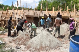 The Water Project: Kyetonye Community -  Shoveling Concrete