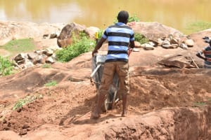 The Water Project: Kithuluni Community C -  Dumping Dirt For Well Construction