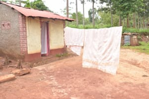 The Water Project: Ivumbu Community -  Blankets Hang To Dry On The Clothesline