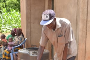 The Water Project: Ivumbu Community -  Fetching Water From Large Storage Container