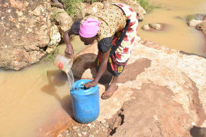 The Water Project: Ivumbu Community -  Filling Container With Water From The River