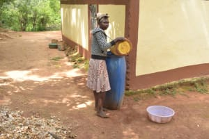 The Water Project: Ivumbu Community -  Filling Water Storage Container