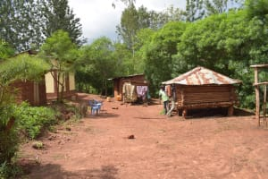 The Water Project: Ivumbu Community -  People Chat In Household Compound