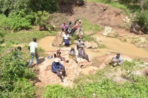 The Water Project: Ivumbu Community -  People Gathered At The River