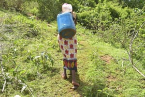 The Water Project: Ivumbu Community -  Treking Up The Hill With A Container Filled With Water