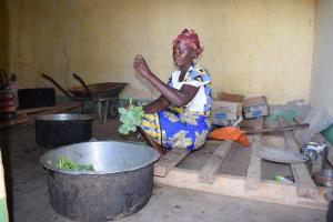 The Water Project: Kakunike Primary School -  School Cook Prepares Kale For Students