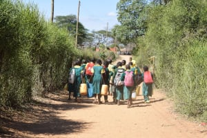 The Water Project: Kakunike Primary School -  Students Carrying Water On Their Way To School