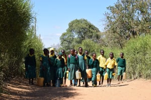 The Water Project: Kakunike Primary School -  Students With Their Water Containers