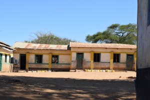 The Water Project: Kakunike Primary School -  Water Containers Lined Up Outside Of Classrooms
