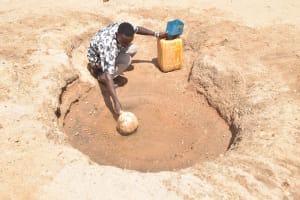 The Water Project: Maviaume Primary School -  Scooping Water