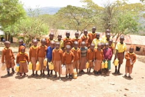 The Water Project: Maviaume Primary School -  Students Holding Water Containers