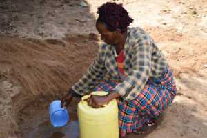 The Water Project: Murwana Primary School -  Collecting Water At The Scoop Hole