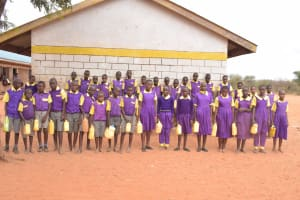 The Water Project: Murwana Primary School -  Students Pose With Their Water Containers