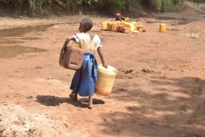 The Water Project: Kwa Kyelu Primary School -  Carrying Containers To Collect Water