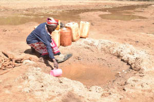 The Water Project: Kwa Kyelu Primary School -  Collecting Water