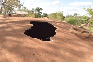 The Water Project: Kwa Kyelu Primary School -  Hole In Decomissioned Tank