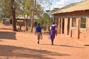 The Water Project: Kwa Kyelu Primary School -  Students Carrying Water