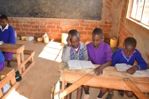 The Water Project: Kwa Kyelu Primary School -  Studying In Class