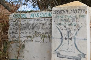The Water Project: Kyandoa Primary School -  School Mission And Motto On Entrance Wall