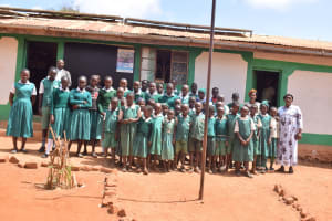 The Water Project: Kyandoa Primary School -  Students Pose In Front Of The School