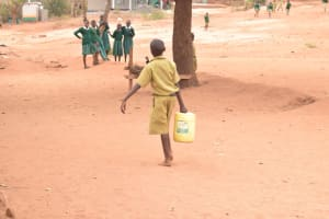 The Water Project: AIC Mbao Primary School -  Carrying Water