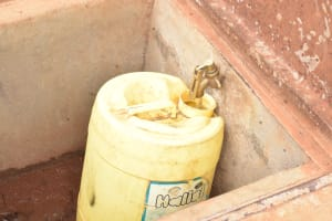 The Water Project: AIC Mbao Primary School -  Collecting Water From Storage Tank