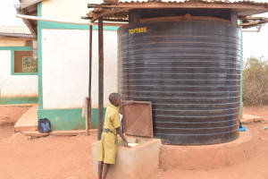 The Water Project: AIC Mbao Primary School -  Filling Container At Water Tank