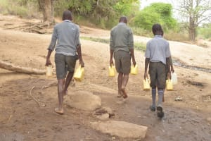 The Water Project: Kithoni Primary School -  Boys Walking Back To School With Water