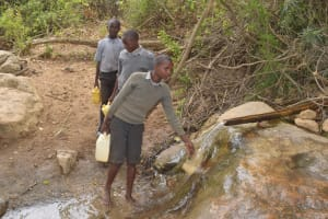 The Water Project: Kithoni Primary School -  Filling Container With Water
