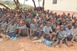 The Water Project: Kithoni Primary School -  Students Waving