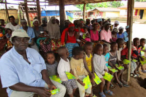 The Water Project: Lungi Town, 112 Alimamy Seray Modu Road -  People Listen During Training Session