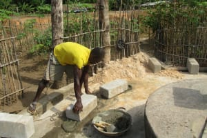 The Water Project: Mapitheri, Port Loko Road -  Laying Bricks For The Wall