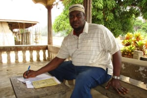 The Water Project: Mapitheri, Port Loko Road -  Pa Alimamy Kamara Auditor Wash Committee Signs The Contract