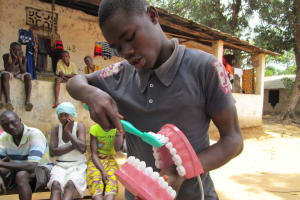 The Water Project: Mondor Community -  Toothbrushing Demonstration