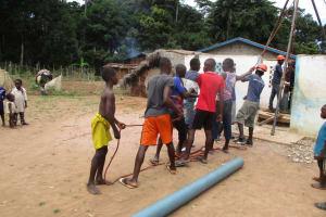 The Water Project: Moniya Community -  Children Help In Drilling