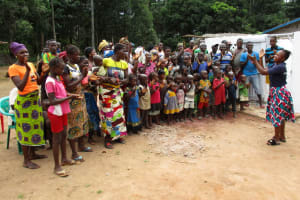 The Water Project: Moniya Community -  Community Members Sing At The Well Dedication