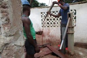 The Water Project: Moniya Community -  Flushing The Well