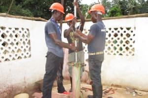 The Water Project: Moniya Community -  Installing The Pump