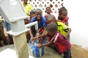 The Water Project: Moniya Community -  Kids Spashing Water