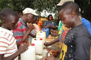 The Water Project: Moniya Community -  Learning To Make Handwashing Stations