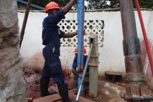 The Water Project: Moniya Community -  Lowering New Casing
