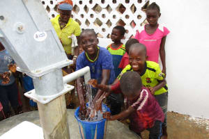 The Water Project: Moniya Community -  Smiles For Reliable Water