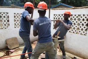 The Water Project: Moniya Community -  Team Using Hand Drill