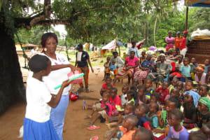 The Water Project: Moniya Community -  Toothbrushing Demonstration