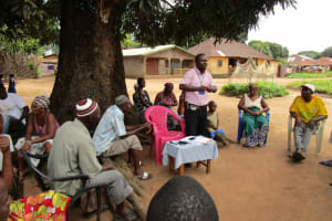 The Water Project: Lungi Town, 112 Alimamy Seray Modu Road -  Facilitator Leads Discussion With Community Members