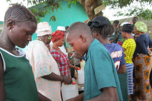 The Water Project: Kamasando DEC Primary School -  Building Tippy Taps For Handwashing At Home