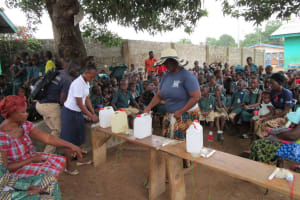 The Water Project: Kamasando DEC Primary School -  Learning About Tippy Taps For Handwashing
