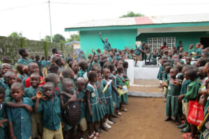The Water Project: Kamasando DEC Primary School -  Students Gathered At Dedication Ceremony