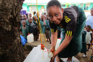 The Water Project: Kamasando DEC Primary School -  Tippy Tap In Use For Handwashing